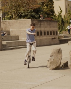 Unicycling by the fountain at Seattle University